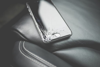 dropped-iphone-6-with-cracked-screen-on-car-seat-picjumbo-com
