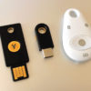 Three hardware security keys for secure second-factor or multi-factor authentication: a Yubico Yubikey 4 in both USB A and USB C form, as well as a Feitian MultiPASS FIDO security token, which uses NFC and Bluetooth. These dongles support hardware-based authentication including IDO U2F, PGP/GPG keys, smart card, OTP (one-time password), smart card, etc.