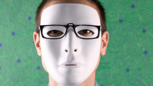 Man wearing hockey mask and glasses