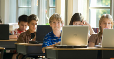 boy_12-13_in_classroom_w-laptop.jpg