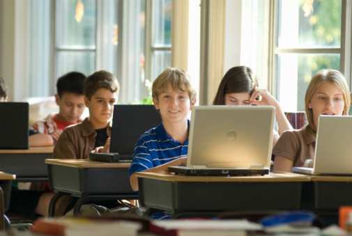 boy_12-13_in_classroom_w-laptop.jpg